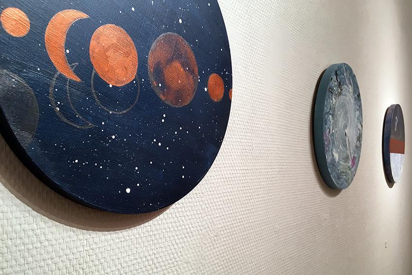 Jossain vaiheessa (on the left) (2019), acrylic & pencil on mdf-board, Ø 29 cm.